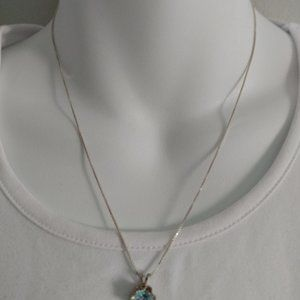 Neclace with birth stone, light blue.